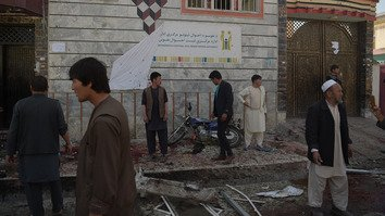 Afghan residents inspect the site of a suicide bombing outside a voter registration centre in Kabul April 22. The bombing took 60 lives. [Shah Marai/AFP]