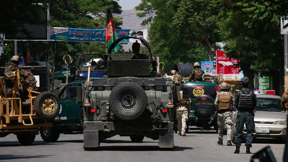 Afghan security forces deploy after co-ordinated attacks on two Kabul police stations May 9. [TOLO News/AFP]