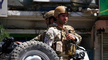 Soldiers stand alert in Kabul after a co-ordinated attacks on two Kabul police stations May 9. [TOLO News/AFP]