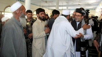 Provincial Governor Mohammad Gulab Mangal (right) May 10 praised residents of Batikot District for driving out Taliban militants from their areas. [Khalid Zerai]