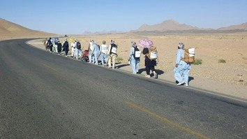 Eight members of the People's Peace Movement in Lashkargah, joined by six others in Kandahar, are walking to Kabul. The group is seen here on the Kabul-Kandahar highway May 21. [Bismillah Watandost/Facebook]