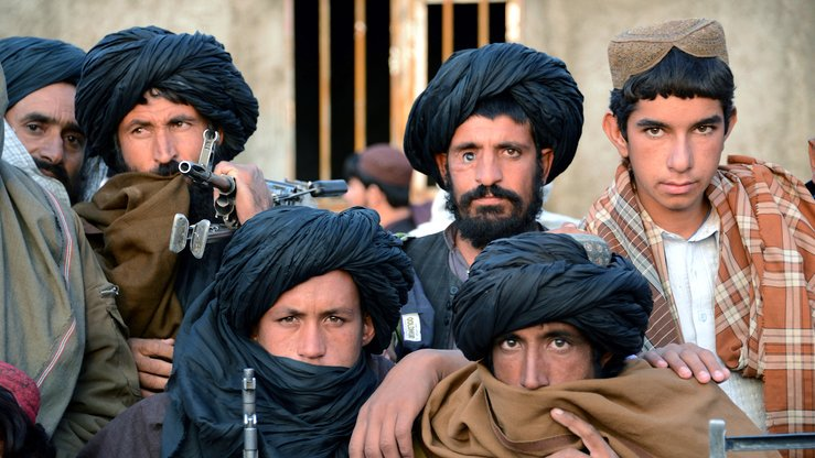 Afghan Taliban fighters look on as they listen to Mullah Mohammad Rasool Akhund (unseen), the newly appointed leader of a breakaway faction of the Taliban, at Bakwah, Farah Province, on November 3, 2015. [JAVED TANVEER / AFP]