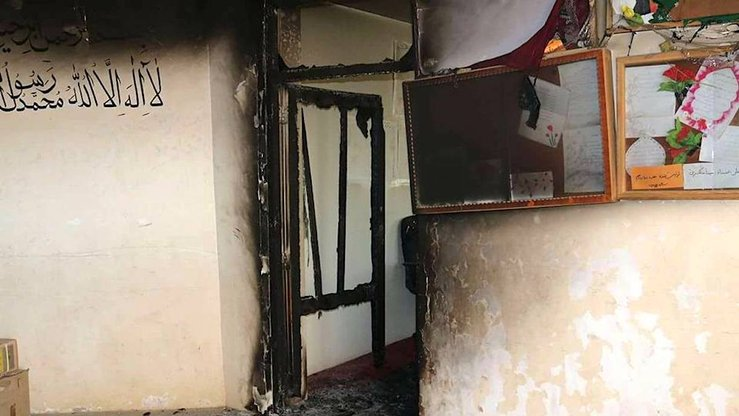 Damage to a girls' school in Mohammad Agha District of Logar Province can be seen after unidentified men attempted to set it on fire on April 10. The first pillar of Islam, the Shahada, is written on the wall. [Afghan Ministry of Education]