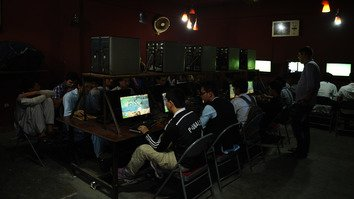 Afghan boys play computer games at a popular place for youth in Kabul on June 1, 2015. The Afghan government should have a stronger online presence in order to fight militant recruiters' propaganda, observers say. [Farshad Usyan/AFP]