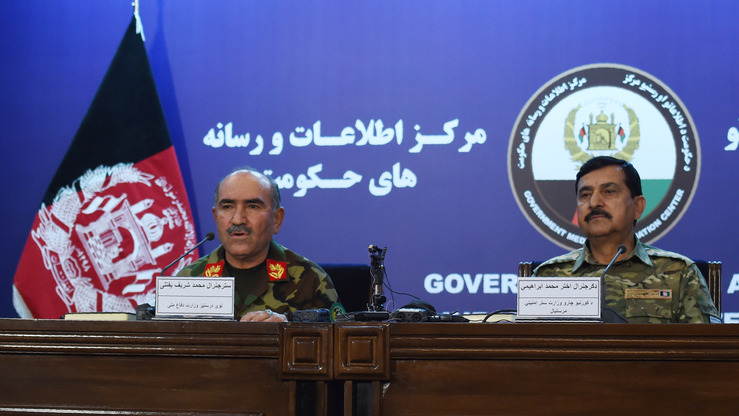 Afghan National Army Chief of Staff Gen. Sharif Yaftali (left) and Deputy Interior Minister Gen. Akhtar Mohammad Ibrahimi (right) hold a news conference in Kabul on June 7. The same day, Afghanistan announced a week-long cease-fire with the Taliban for Eid, though operations against other groups including ISIS will continue. [WAKIL KOHSAR/AFP]