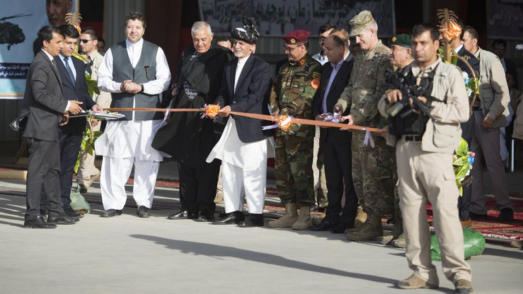 President Ashraf Ghani cuts a ribbon inaugurating the UH-60 Black Hawk helicopter into the AAF during a ceremony at Kandahar Airfield last October 7. [Staff Sgt. Benjamin Gonsier/US Air Force]