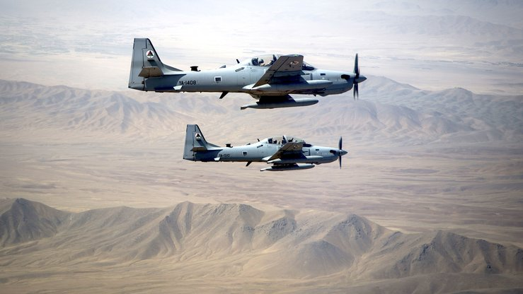 AAF A-29 Super Tucanos fly a two-ship formation over Kabul August 14, 2015. [Staff Sgt. Larry E. Reid Jr./US Air Force]