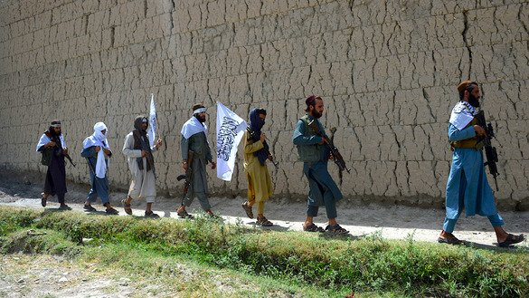Taliban militants walk on the outskirts of Jalalabad June 16 as they take to the street to celebrate the ceasefire on the second day of Eid ul Fitr. [Noorullah Shirzada/AFP]