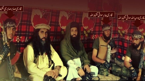Mullah Fazlullah (centre), the deceased Tehreek-e-Taliban Pakistan (TTP) leader, is pictured sitting next to future successor Umar Rehman (second right) in a TTP statement claiming responsibility for last December's attack on the Agricultural Training Institute in Peshawar. [Courtesy of Muhammad Ahil]