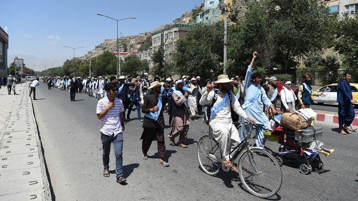 Afghan peace activists arrive in Kabul June 18 after marching from Helmand to demand an end to the war. Dozens marched hundreds of kilometres and arrived in the capital as the Taliban ended their three-day ceasefire. [Wakil Kohsar/AFP]