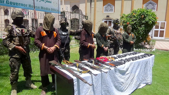 Local authorities in Nangarhar Province present detained ISIS members to the media June 20. [Khalid Zerai]