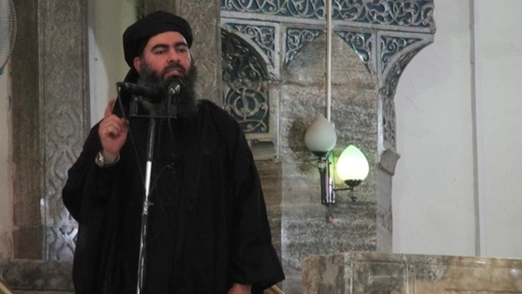 "Abu Bakr al-Baghdadi declares the creation of the ""Islamic State"" at the al-Nuri Mosque in Mosul, Iraq, in 2014. Al-Baghdadi is from Iraq and was part of al-Qaeda before he became the founder of ISIS. [File]"