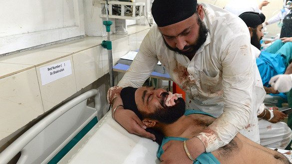 A Sikh man receives medical treatment after a suicide attack in Jalalabad July 1. [Noorullah Shirzada/AFP]