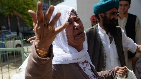 A Sikh woman weeps during a burial ceremony July 2, a day after a suicide attack in Jalalabad claimed by ISIS. [Noorullah Shirzada/AFP]