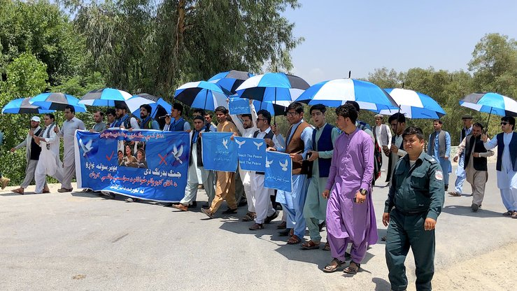 A group of Afghan refugee youth can be seen in Jalalabad on June 21 after starting a peace caravan earlier that day. The group marched from Peshawar to Kabul to demand the Taliban make peace. [Khalid Zerai]