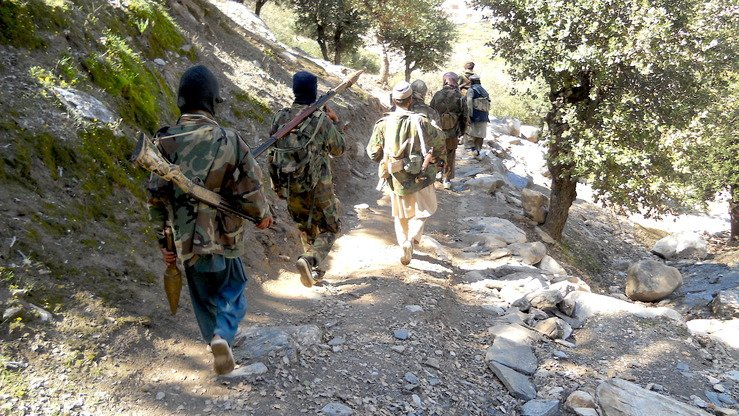 Taliban militants move through Chapa Dara District, Kunar Province, in 2016. [File]