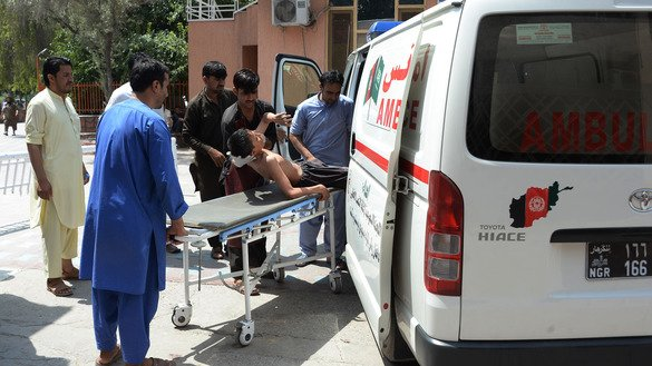 Afghan volunteers carry an injured youth on a stretcher to a hospital following an attack that targeted a provincial education department compound in Jalalabad July 11. [Noorullah Shirzada/AFP]