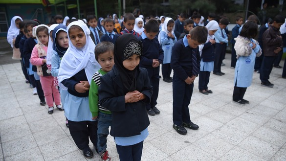 Pupils stand in line March 24 on the first day of the school year in the courtyard of a private school in Kabul. In Logar Province, the Taliban have again closed schools as retaliation for military operations. [Wakil Kohsar/AFP]