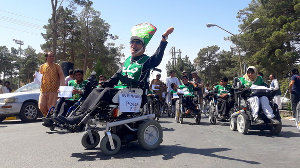 Men and women in wheelchairs chant slogans for peace in Herat city July 21. [Nasir Salehi]