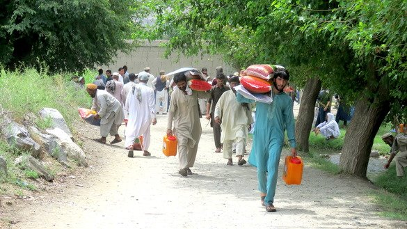 Hundreds of displaced families receive food and non-food aid from the Afghan government July 23 following operations to clear ISIS from Nurgal District, Kunar Province. [Khalid Zerai]
