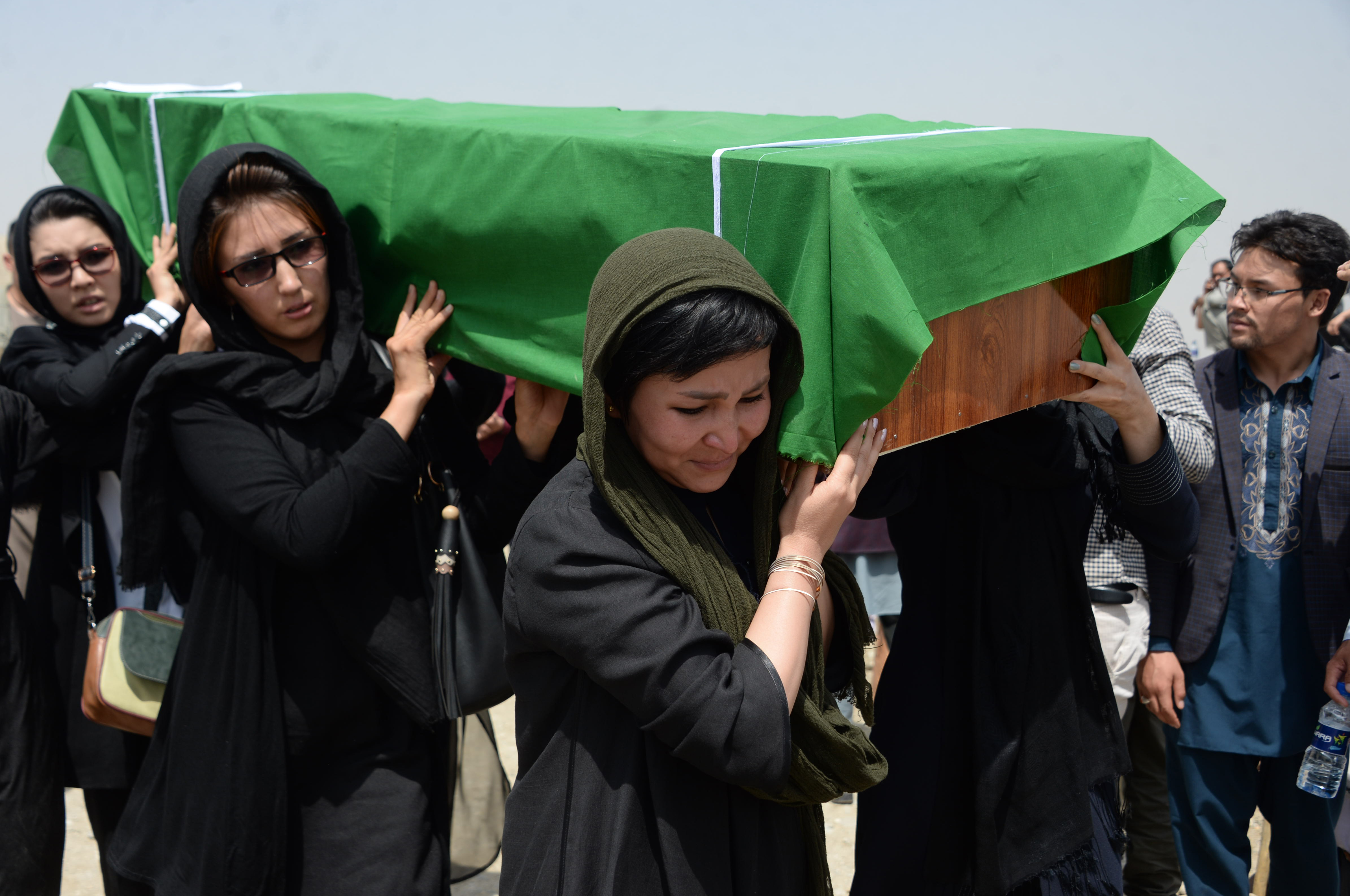 Militants mount failed attack on intelligence centre as mourners bury teen dead