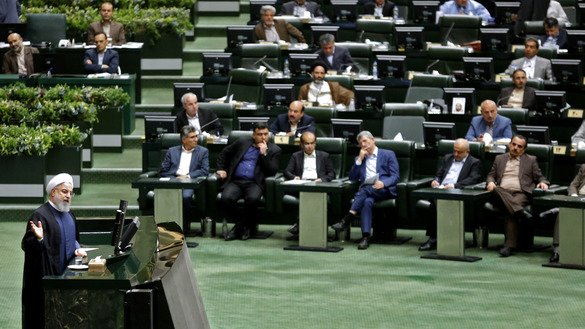 Iranian President Hassan Rouhani addresses parliament in Tehran August 28. It was the first time Rouhani had been summoned by parliament in his five years in power, with members demanding answers on unemployment, rising prices and the collapsing rial, which has lost more than half its value since April. [Atta Kenare/AFP]