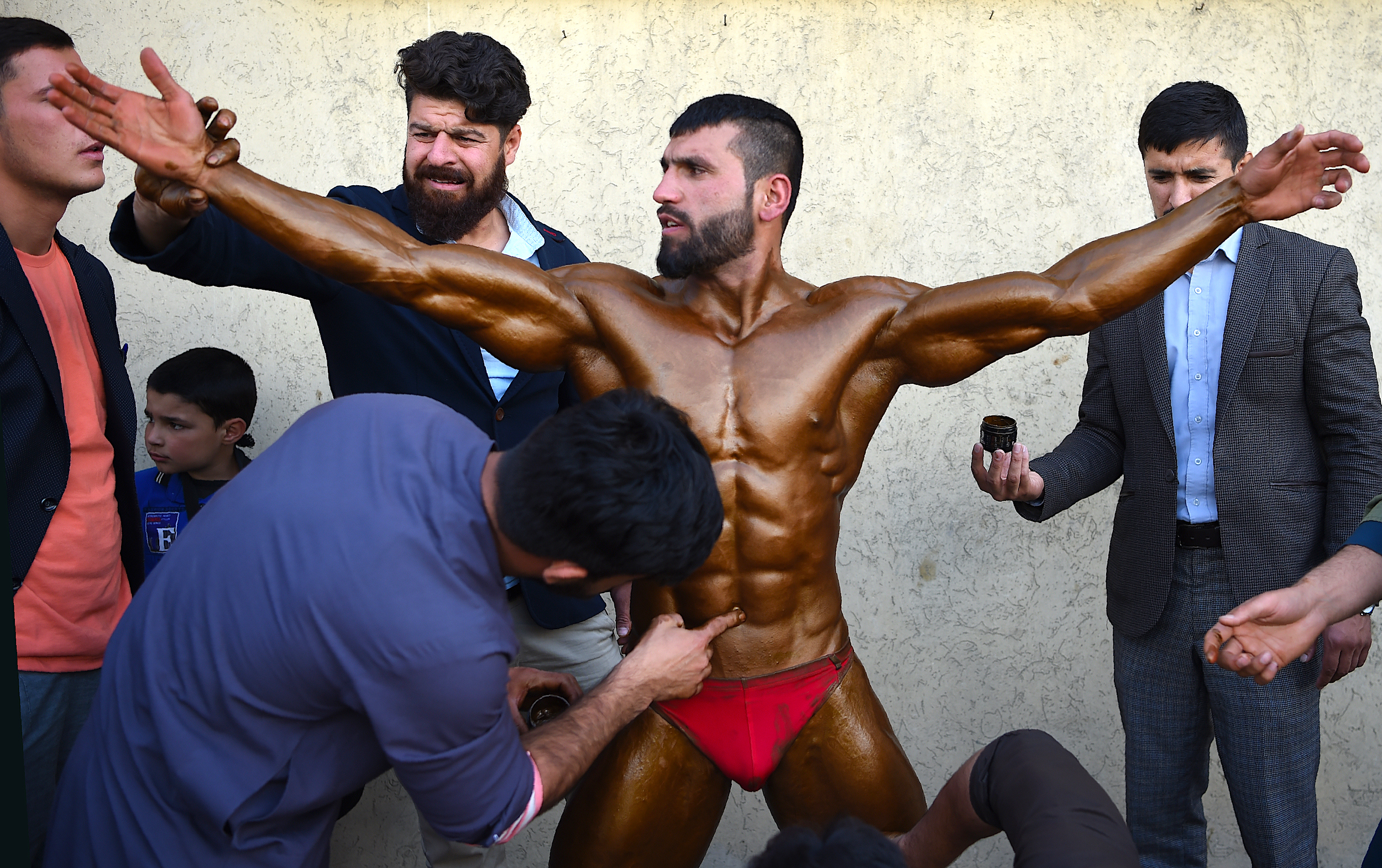 Young men take to bodybuilding gyms in war-torn Kabul