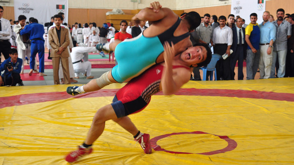 Afghanistan's Olympic hopefuls mark 'One Year to Go to London 2012' at a wrestling match on July 28, 2011. [UK in Afghanistan/Flickr]