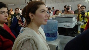 Pakistani actress and UNHCR Goodwill Ambassador Mahira Khan visits the Azakhel Voluntary Repatriation Centre with a UN delegation to witness the repatriation process September 8. [Muhammad Ahil]