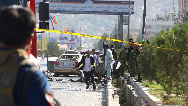 Afghan security personnel inspect the site of a suicide bombing in Kabul September 9. [AFP]