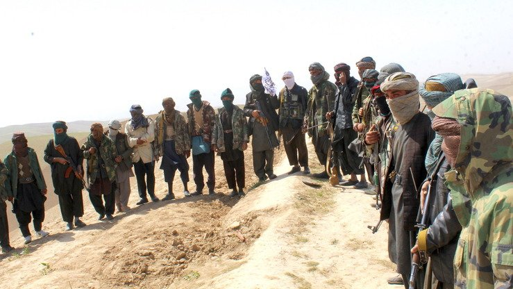 An April 5 photo shows Taliban militants in Gosfandi District, Sar-e-Pul Province, before they handed over their weapons to authorities. [File]