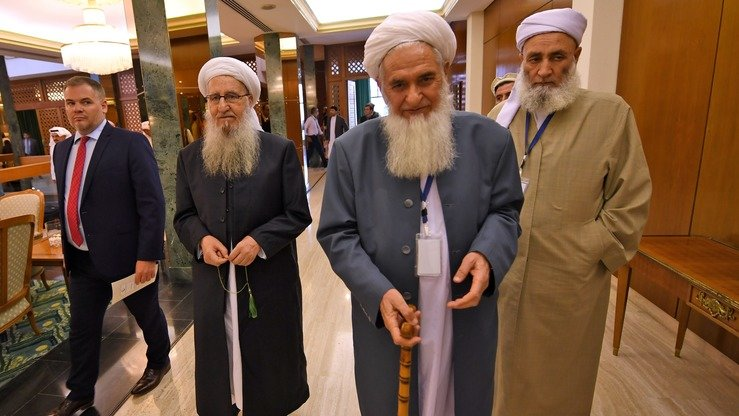 Delegates July 10 in Jeddah, Saudi Arabia, arrive for an international ulema conference on Afghan peace. The Taliban spurned the conference. [Amer Hilabi/AFP]