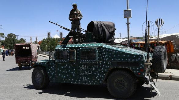 Afghan security forces patrol a road in Ghazni city August 14. Afghan troops appeared to have pushed the Taliban out of the strategic city August 15. [ZAKERIA HASHIMI/AFP]
