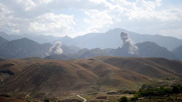 "In this photo taken July 7, smoke rises after an air strike hit ""Islamic State of Iraq and Syria"" (ISIS) positions in Deh Bala District, Nangarhar Province. [Wakil Kohsar/AFP]"