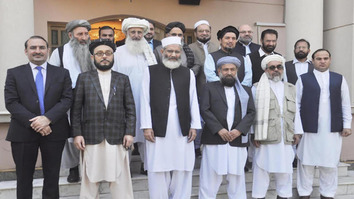 An Afghan High Peace Council delegation poses with Siraj ul Haq (3rd left), chief of Jamaat-e-Islami, in Islamabad on October 1. [Jamaat-e-Islami]