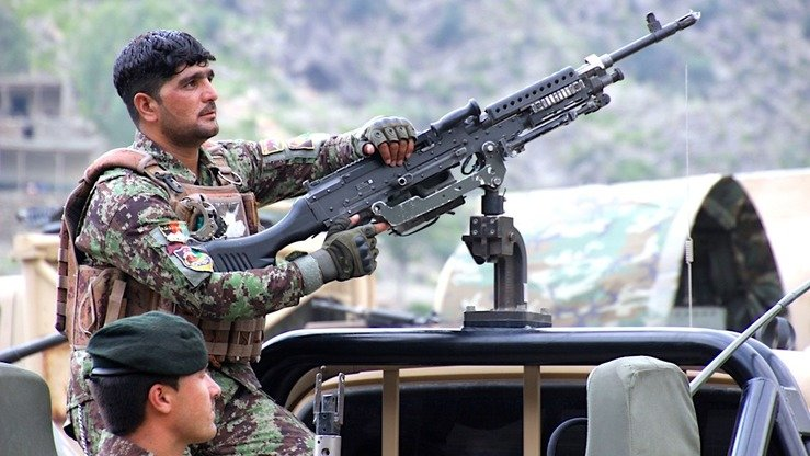 An Afghan National Army commando September 1 watches for militants during a clearance operation in Dewagal Valley, Sawkai District, Kunar Province. [Khalid Zerai]