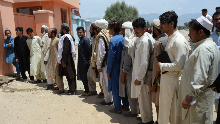 Afghan men line up to register themselves to vote in upcoming parliamentary and district council elections, in Bihsood District on the outskirts of Jalalabad in Nangarhar Province on July 5. [Noorullah Shirzada/AFP]