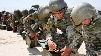 Afghan National Army (ANA) soldiers conduct drills October 13 ahead of the parliamentary elections next Saturday at Camp Shorabak, an Afghan military base near Lashkargah, Helmand Province. [Zia Samar]