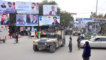 In photos: Security forces hold military parade in Kunduz ahead of a crucial vote