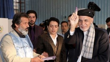 President Ashraf Ghani shows his ink-stained finger after casting his ballot in the parliamentary polls October 20 in Kabul. [ARG Presidential Palace]