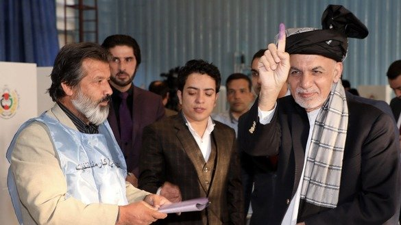 Millions of Afghans defy Taliban threats, cast votes in