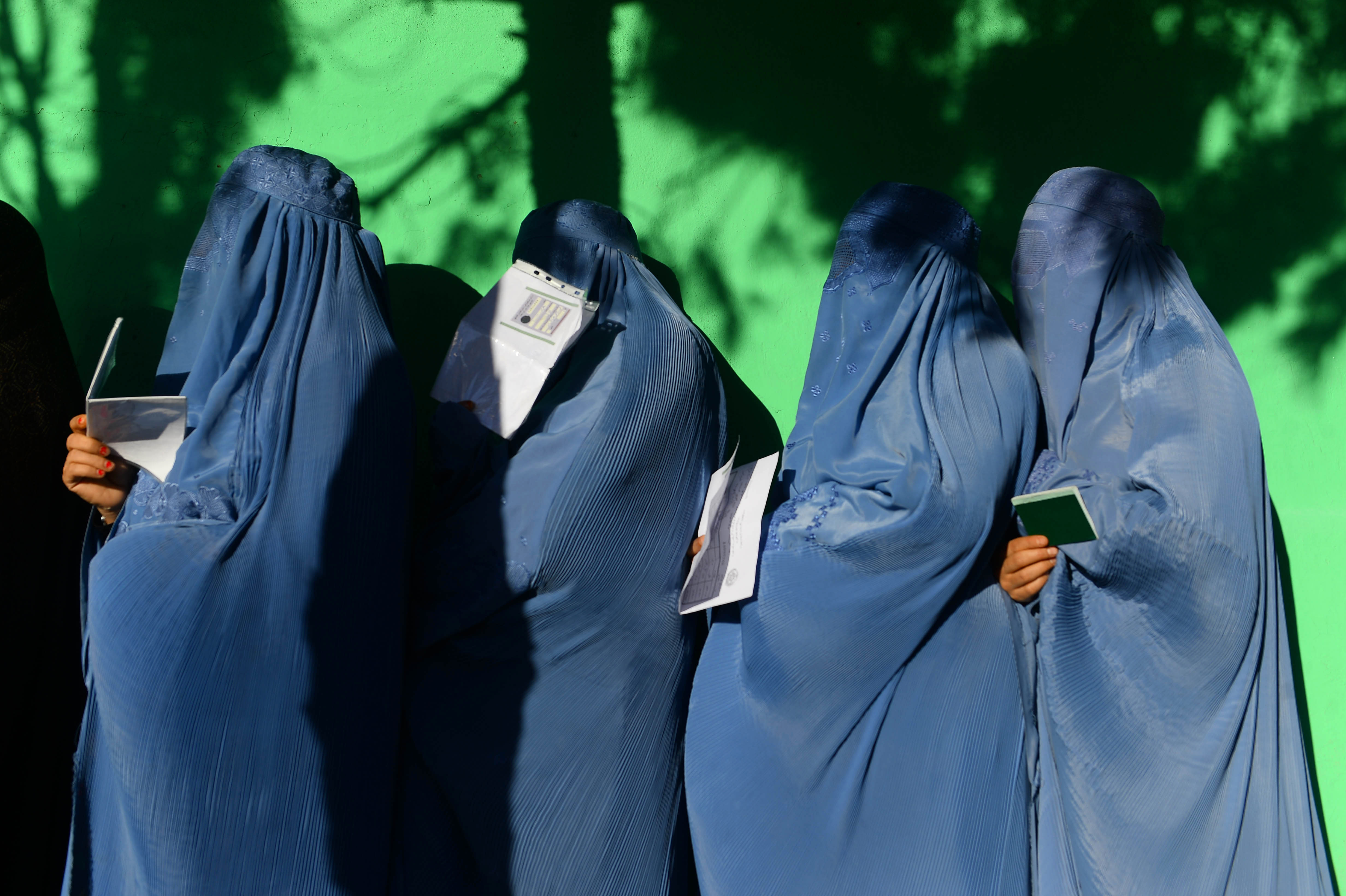 Millions of Afghans defy Taliban threats, cast votes in historic elections