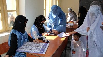 Afghan women are seen in Lashkargah, Helmand Province, voting in the October 20 parliamentary election. [Zia Samar]