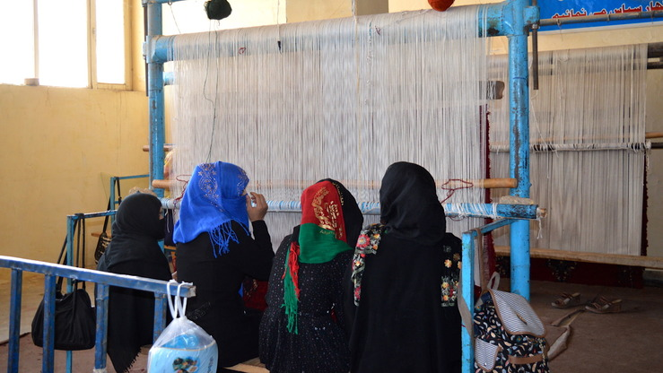 Women weave a carpet at a technical and vocational training centre in Kunduz Province September 23. [Hedyatullah]