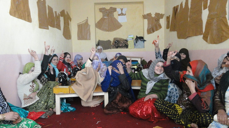Women participating in a training course on sewing and dressmaking in Kunduz Province pose for a photograph May 1, 2012. [Women's Affairs Directorate of Kunduz Province]