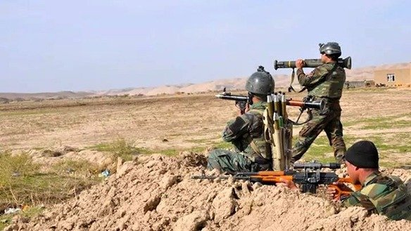 ANA soldiers take position during anti-Taliban operations on the outskirts of Farah city November 19. [Press office of the 207th Zafar Corps of the Afghan National Army]