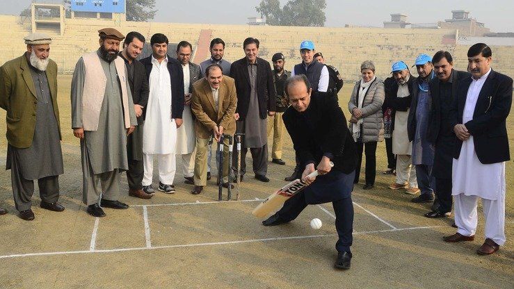 Commissioner for Afghan Refugees in KP Muhammad Abbas Khan inaugurates the new cricket league for Afghan refugees in Peshawar December 5. [Shahbaz Butt]