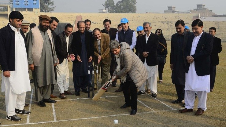 UNHCR representative Kiran Kaur swings at the ball in Peshawar December 5. [Shahbaz Butt]