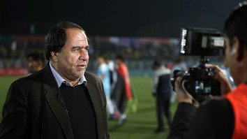 The Attorney General's Office has suspended Afghanistan Football Federation (AFF) President Keramuddin Karim, shown in Kabul October 6, and five other AFF members while it investigates allegations of physical and sexual abuse against female players. [Afghanistan Football Federation/Facebook]