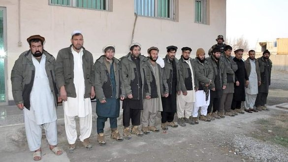 Kabul police released a photograph of 13 of Tamim Shansab's bodyguards, who were arrested December 4 after a standoff that lasted at least 20 hours. [Kabul Police/Facebook]
